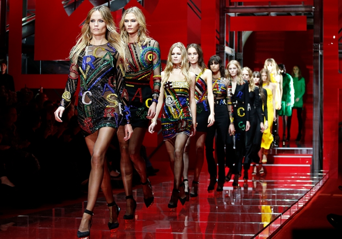 Models parade at the end of the Versace Autumn/Winter 2015 /16 collection during Milan Fashion Week